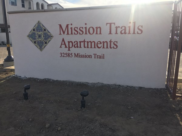 Monument sign for Mission Trails Apartments in Corona, CA